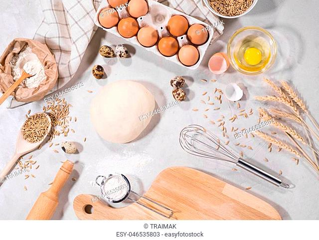 Top view of dough ingredients for cooking on kitchen table isolated on grey backround home-bakery concept