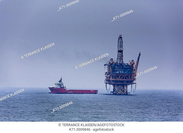 An ocean oil rig and supply ship in the South China Sea near Japan