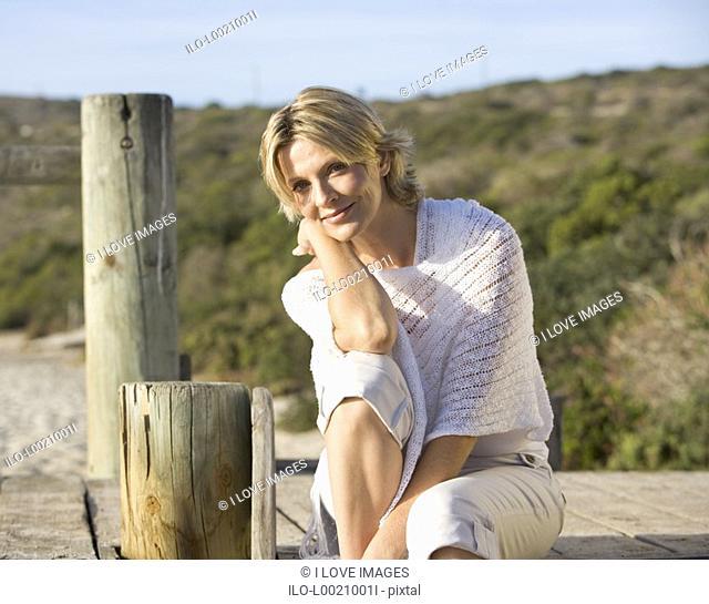 A woman sitting on a beach