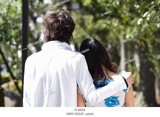 Young couple walking in a park