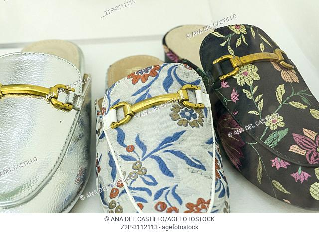 Flowered Shoes for men at window Italy