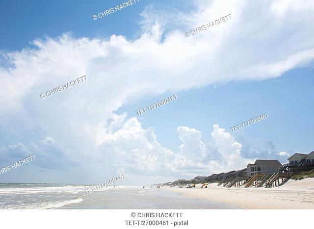 USA, North Carolina, Topsail Island, Clouds above sea and sandy beach