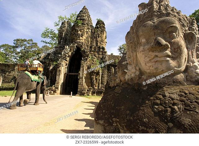 Elephant rides at the gateway to Angkor Thom. Angkor Thom (Big Angkor) is a 3km2 walled and moated royal city and was the last capital of the Angkorian empire
