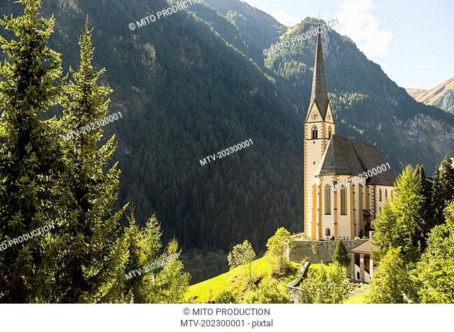 St Vincent church with mountain in the background, Heiligenblut, Carinthia, Austria