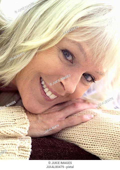 Close up of middle-aged woman smiling