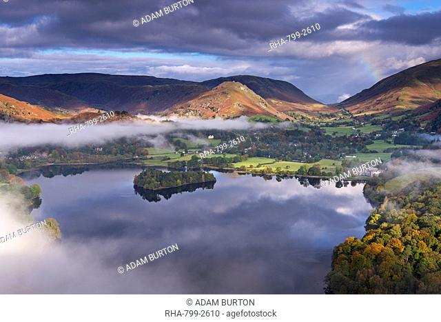 Mist burns off Lake Grasmere in the early morning, Lake District National Park, Cumbria, England, United Kingdom, Europe