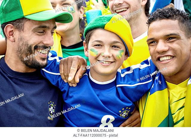 Brazilian football fans bonding at match, portrait