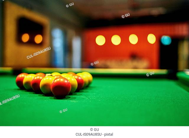 Close up of yellow and red pool balls on pool table