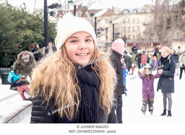 Smiling girl on ice rink