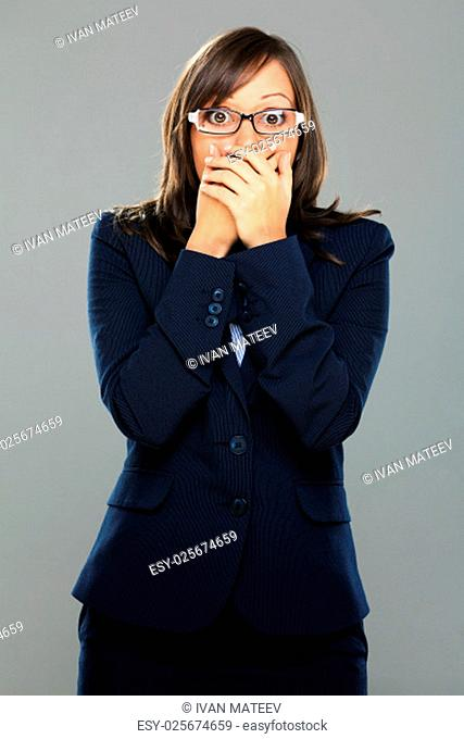 Businesswoman expressing surprise isolated on gray background