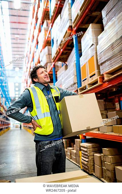 Worker Warehouse holding parcel