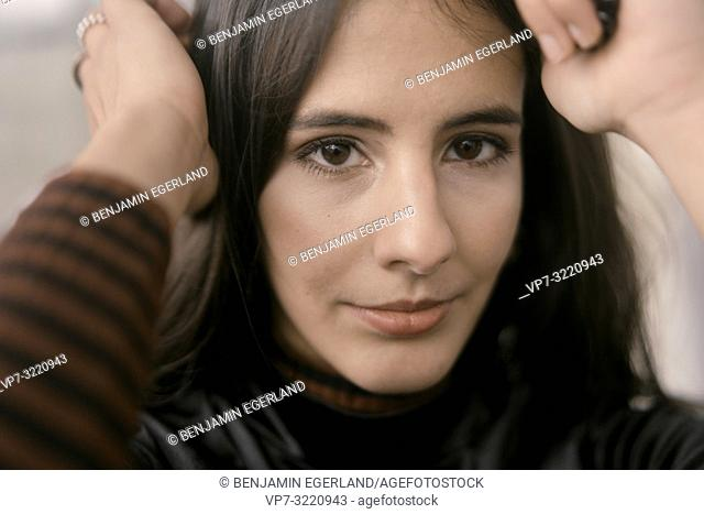 intimate close-up portrait of fashionable woman, sensitive character, in Munich, Germany