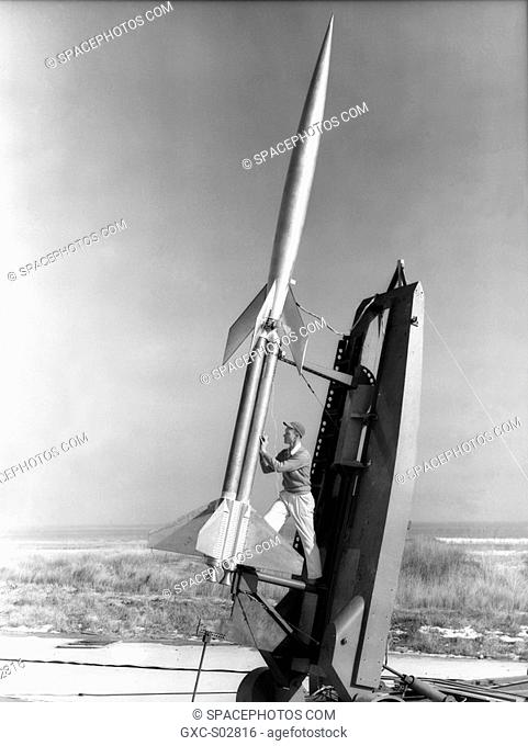 Technician Durwood Dereng measures elevation of double Deacon booster prior to launch of RM-10 research model at Wallops, February 6, 1951
