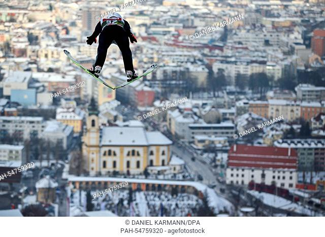 Kamil Stoch of Poland soars through the air during a training session for the third stage of the 63rd Four Hills Tournament ski jumping event in Innsbruck