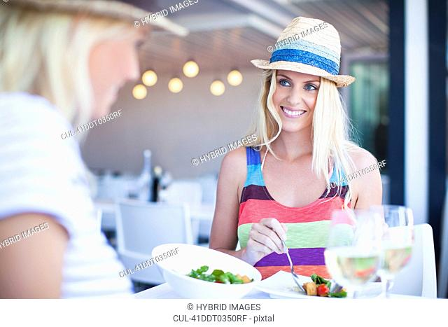 Women eating together in cafe