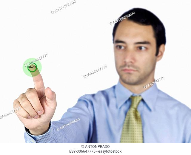 Young business man touching a start button on the screen