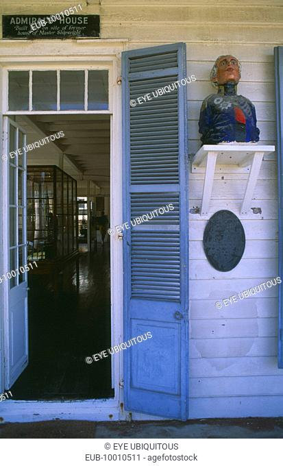 Admirals House doorway with wooden carving of naval officer on the wall