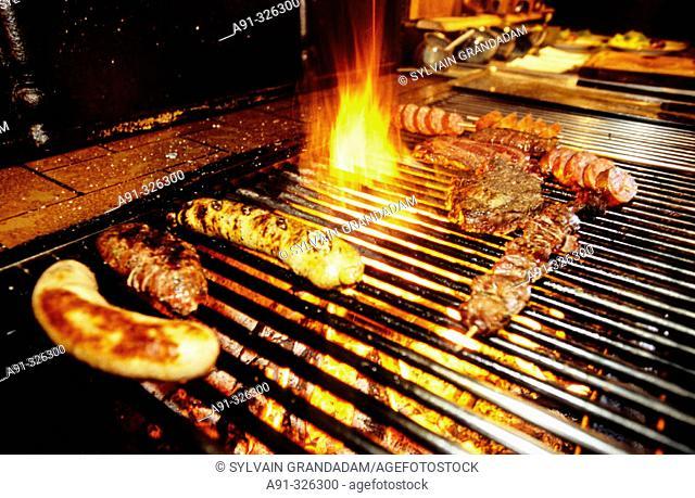Grilling Morteau sausages. Auberge La Boissaude inn. Route du Mont d'Or, Doubs. Franche-Comté, France