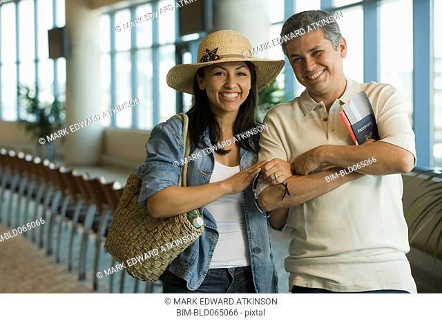 Hispanic couple waiting in airport