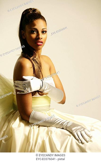 Young African American woman in elegant gown, studio shot