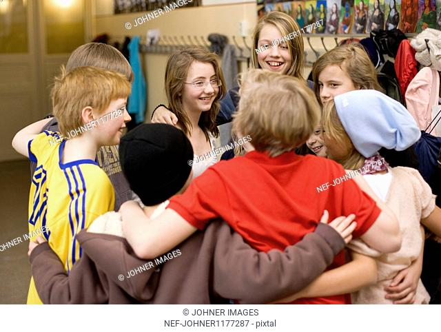 Children standing in circle and hugging
