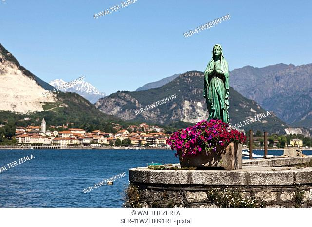 Ornate statue on waterfront wall