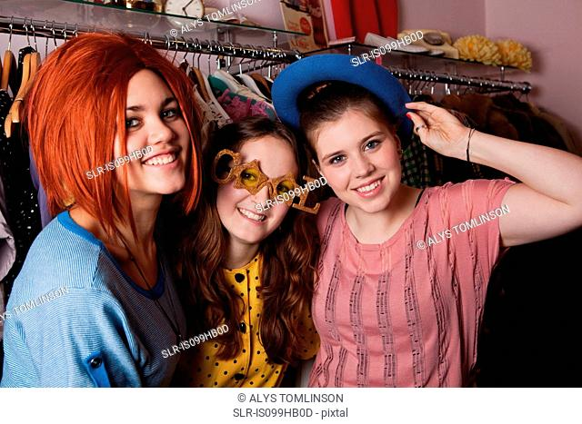 Young women dressed in costumes in clothes shop, portrait