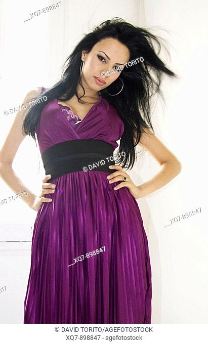 Transexual girl wearing purple dress