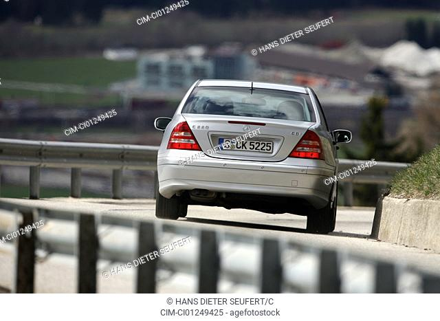 Mercedes C 220 CDI, model year 2005-, silver, driving, diagonal from the back, rear view, country road