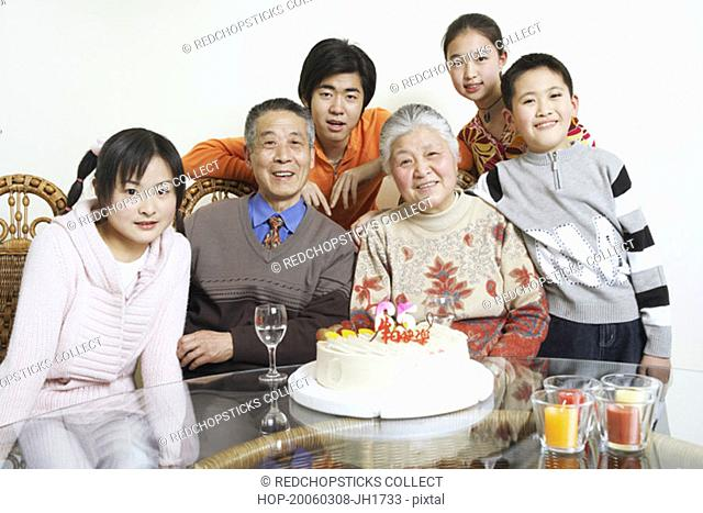 Portrait of a family at a birthday party