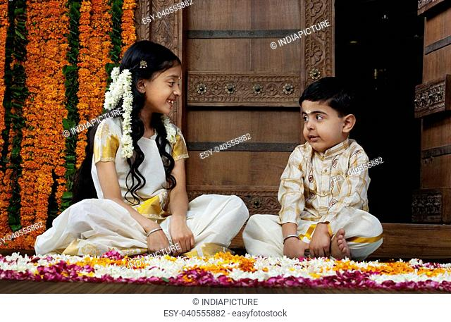 South Indian girl sitting with her brother