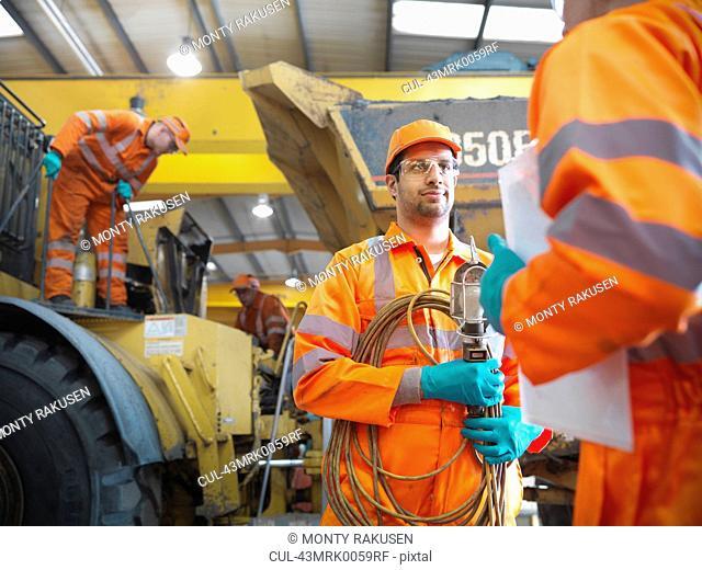 Engineer talking to apprentice