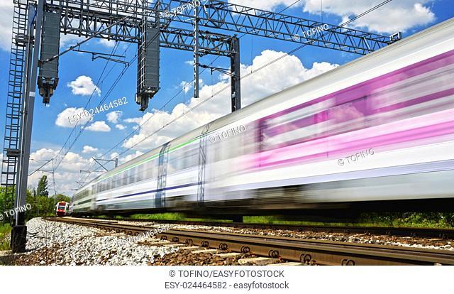 Modern electric passenger train moving on full speed