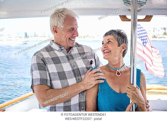 Smiling couple on a boat trip