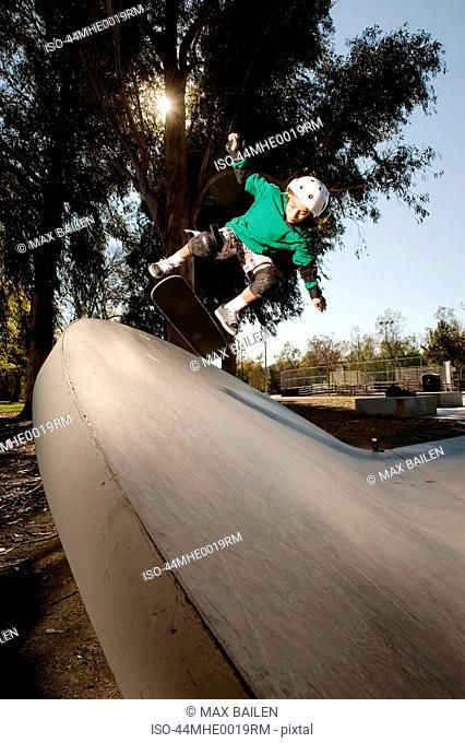 Boy skating at skatepark