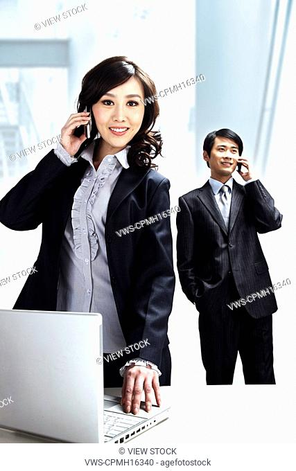 Businesspeople with cellphone