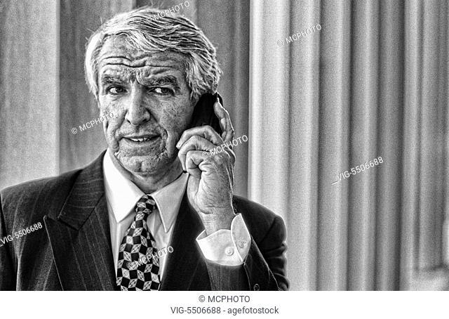 Senior businessman using cellular phone - , 01/01/1931