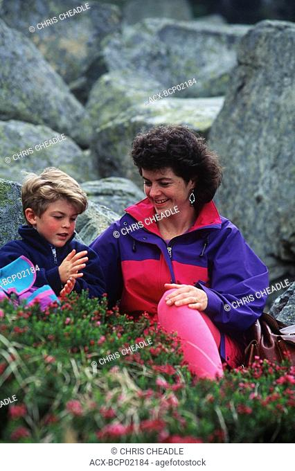 mother and son in heather, Whistler Mountain, British Columbia, Canada