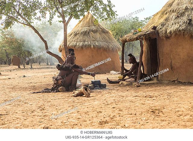 Traditional Himba Huts With Working Tribes Woman