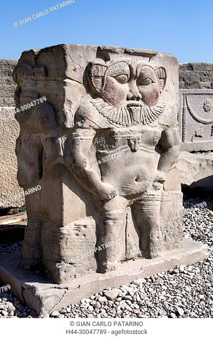 Dendera Egypt, ptolemaic temple dedicated to the goddess Hathor: a column with the god Bes