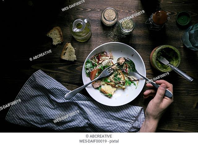 Eating mixed salad with tuna