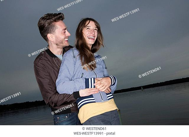 Germany, Berlin, Lake Wannsee, Young couple laughing