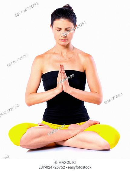 Young woman doing yoga. Isolated on white backgraund
