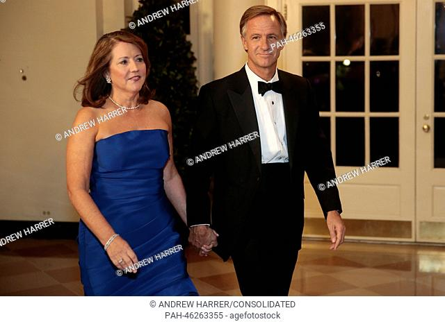 "Governor William """"Bill"""" Haslam of Tennessee, right, and Crissy Haslam arrive to a state dinner hosted by U.S. President Barack Obama and U.S"