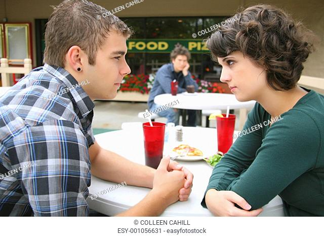 a young couple in a fight as a young man looks on, troutdale, oregon, united states of america