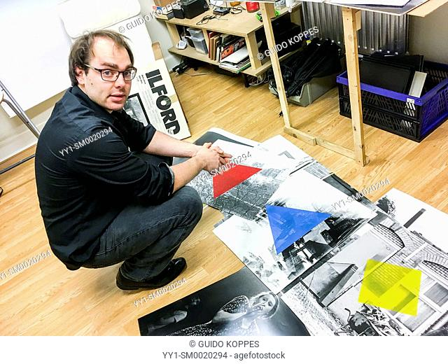 Tilburg, Netherlands. Portrait analog photographic artist inside his studio and darkroom