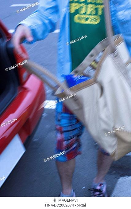 Man Holding a Shopping Bag