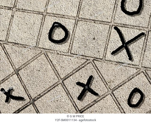 noughts and crosses scattered on pavement tiles