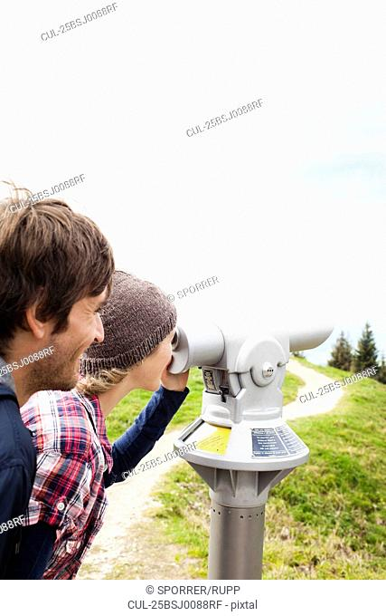 Couple using telescope