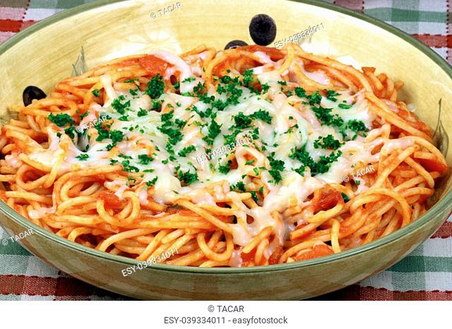 Delicious and perfect made to perfection asta with parmesan cheese and exquisite fresh organic tomatoes sauce vegans or vegetarians will love it